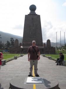 The Mitad del Mundo monument, and a tourist