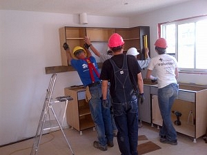 Martha and crew installing kitchen cabinets